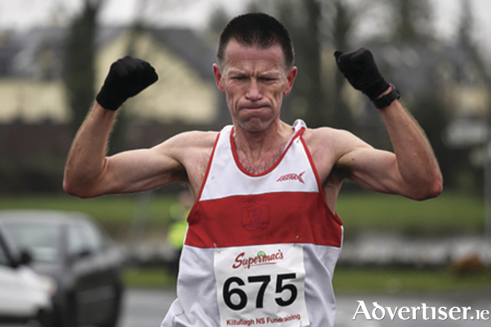 Gerry Carty of GCH celebrates victory at the Kiltullagh 10k.