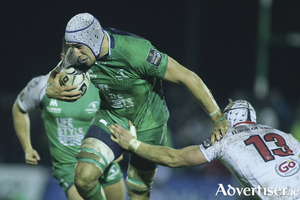 Connacht lock Ultan Dillane is tackled by Ulster's Luke Marshall in action from the Guinness Pro12 game at The Sportsground on Saturday.  Photo:-Mike Shaughnessy