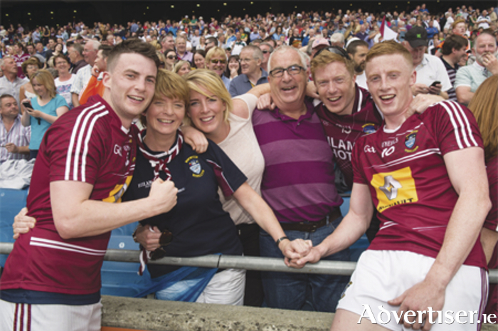 Westmeath players John Connellan (left) and his brother Ray (right) are congratulated by their mother, Mary; sister, Eimer; dad, Paul; and brother, David after defeating Meath in the Leinster GAA Football Senior Championship semi-final at Croke Park, Dublin.