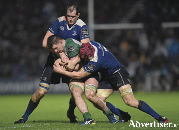 Connacht No 8  Eoghan Masterson is tackled by Devin Toner and Josh van der Flier in the New Year's Day Pro 12 fixture.