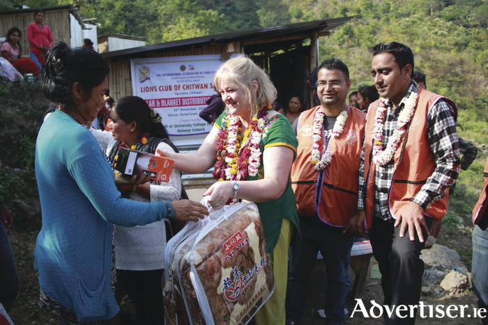 Brid Gavin O'Connell distributing aid to the earthquake victims of Nepal.