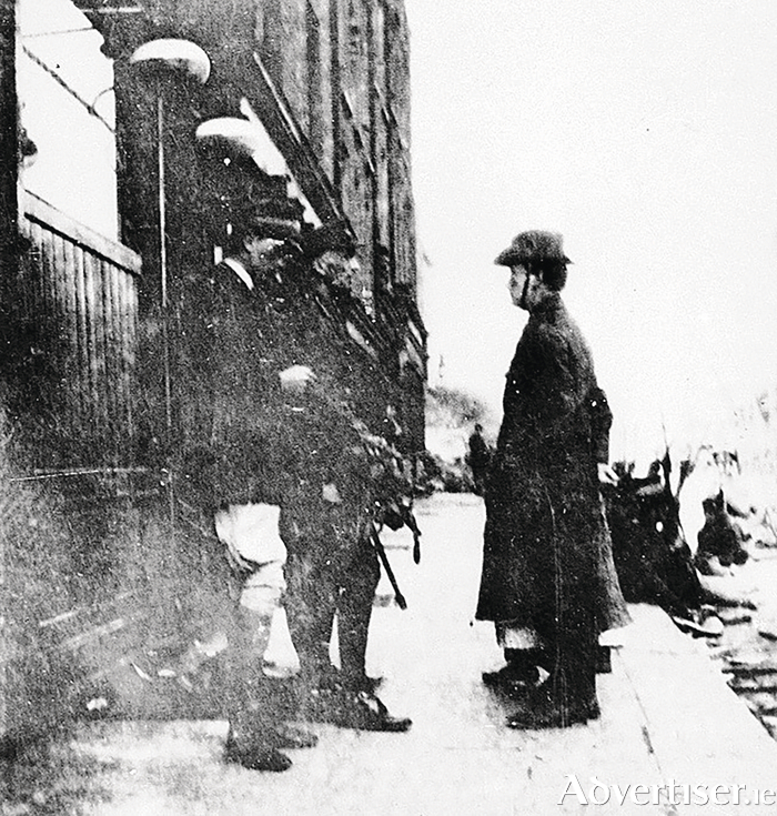 Padraic Pearse surrenders to Brig General William Lowe. Look closely, and you can just make out the boots belonging to Nurse O'Farrell, on Pearse's right side. Her body was airbrushed away.   (Picture taken from The Easter Rebellion 1916 - A New Illustrated History, by Conor McNamara,  now on sale €24.99).
