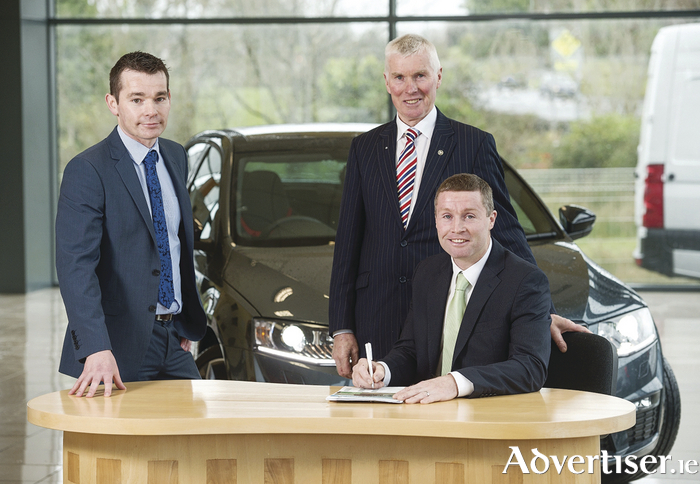 William Lee of Skoda Ireland with Al Hayes and Damien Hayes of Al Hayes Motors Ltd  as they sign the contract to become Skoda dealers for Clare. (Photo John Kelly)