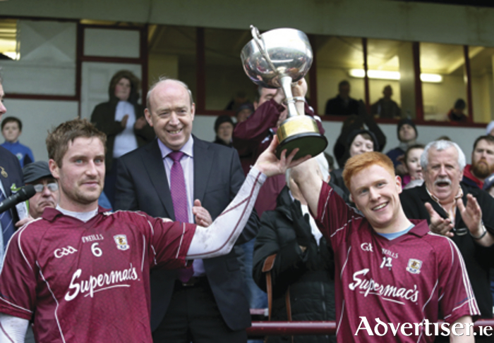 Pictured right: joint Galway captains Gary O'Donnell and Adrian Varley celebrate after they were presented with the cup after Galway defeated Roscommon at the FBD Connacht League Final at Tuam Stadium. Also in the photograph is Tommy Kelly of FBD.