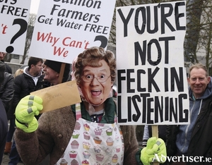 A protester as Mrs Brown at the anti water charges demonstration in Galway in 2014, and water charges might be one of the issues of Election 2016. Photo:- Hany Marzouk