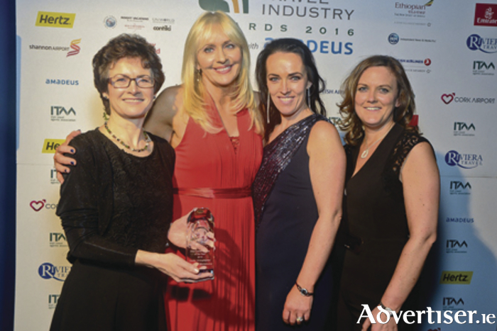 Maura Fahy of Fahy Travel accepts the award for ITAA Travel Agent of the Year from Miriam O' Callaghan at a ceremony at the Mansion House in Dublin. Also pictured are Fahy Travel employees, Caroline O'Toole, and Clodagh Connolly.