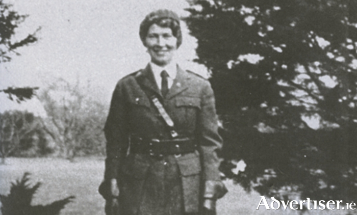 Cumann na mBan: A military-style green uniform was adopted, consisting of a coat, hat and skirt, plus a haversack and first aid kit. In addition they also wore a badge with a rifle and the initials C na mB intertwined. The lady in the picture is Sighle Humphreys.