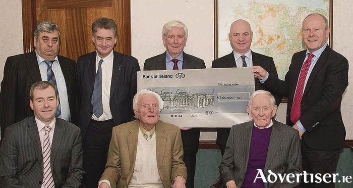 Pictured at the the presentation of a cheque to Mayo County Council from Castlebar Community Development Association for €400,000, the community contribution to the development of the Castlebar Swimming and Outdoor Pursuits Centre were, back row: Martin Waters (Community Development Association), John Condon (Mayo County Council), Paddy McGuinness (Community Development Association), Peter Hynes (chief executive, Mayo County Council), and Paddy Mahon (director of services, Mayo County Council). Front row: Peter Duggan (head of finance, Mayo County Council), Tommie Robinson (Community Development Association), and Billy Flynn (Community Development Association). Photo: Tom Campbell.
