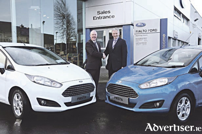 Ciarán McMahon, managing director of Ford Ireland, with Dr Senan Mullins, CEO, The Care Trust, announcing Ireland's biggest car giveaway.
