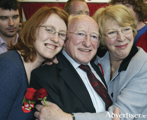 Alice Mary Higgins with her parents Michael D and Sabina.