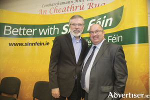 Trevor Ó Clochartaigh with SF party president Gerry Adams.