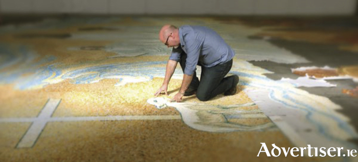 Prominent Irish artist PJ Lynch working on the imagery for the Knock mosaic last year. Photo: PJ Lynch.