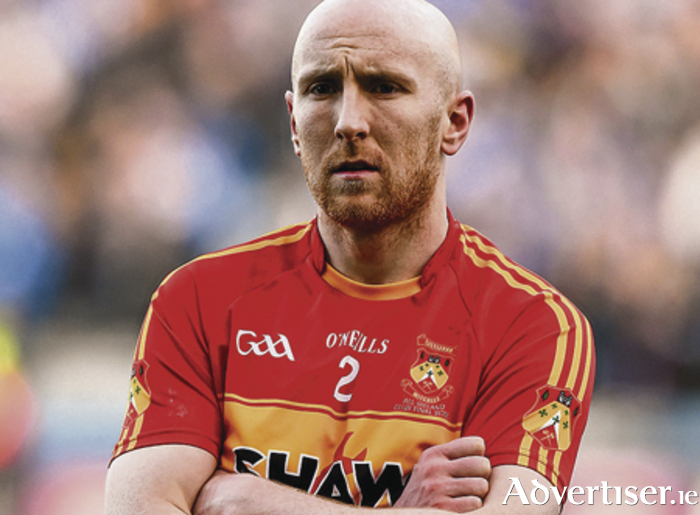 Feeling the pain of defeat — Tom Cunniffte, Castlebar Mitchels watches the cup presentation.