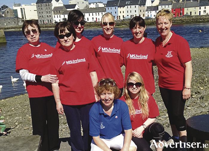 Mary and Teresa Flanagan pictured with MS supporters at last year's walk