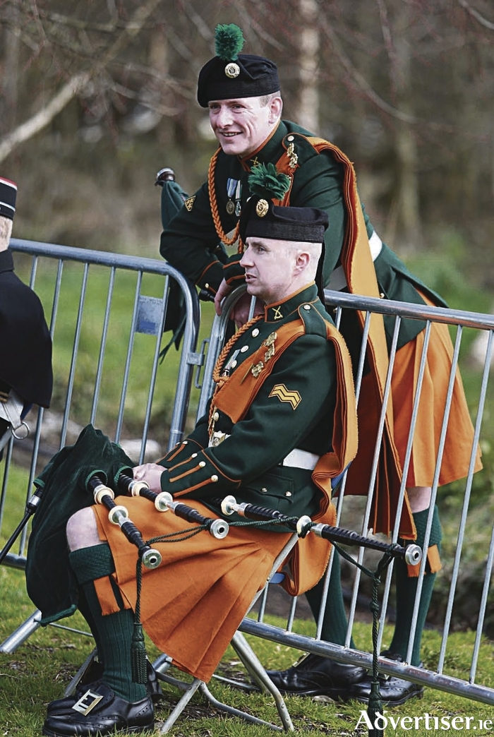 Pipers of the army band at rest at the 1916 commemoration state ceremony in Athenry, Co. Galway. 				Photo: Hany Marzouk