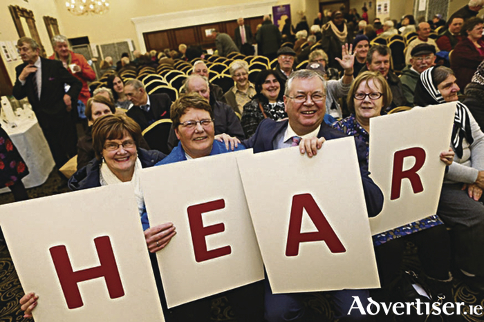 Joe Duffy pictured with attendees at last year's Hidden Hearing health awareness event.