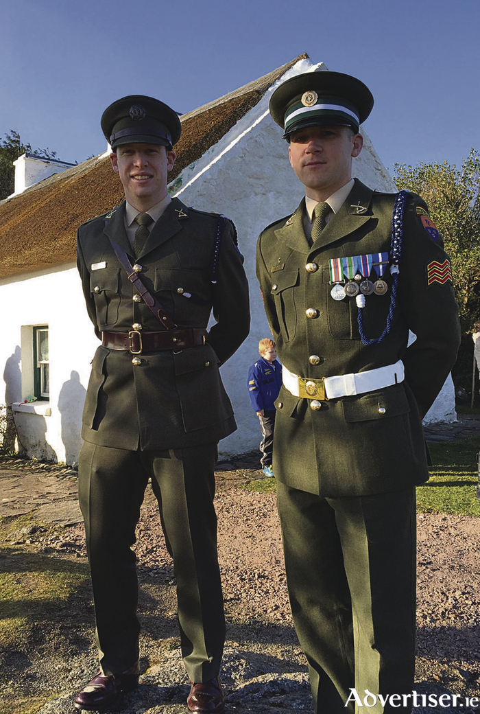 Lt Shay Ó Giolláin from Dublin and Sgt Ian Seoighe from An Cheathrú Rua/Carraroe pictured at Pearse's Cottage in Ros Muc, Connemara, on Easter Monday morning during a live broadcast from there by RTÉ Raidió na Gaeltachta morning current affairs programme Adhmhaidin, which was also marking 30 years on air on Monday.