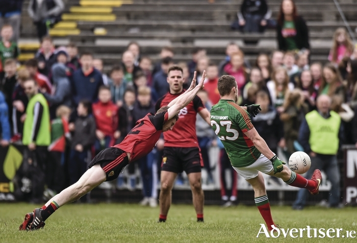 Stroking it over: Andy Moran kicks a vital late point for Mayo against Down. Photo: Sportsfile