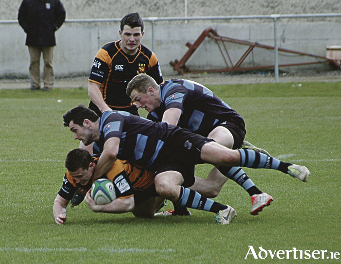 Buccaneers fullback Callum Boland comes under pressure from Shannon duo Richie Mullane and Stephen Fitzgerald