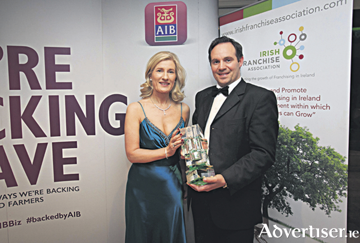 Pictured at the Irish Franchise Awards in association with AIB at the Radisson St Helen's Hotel, Dublin was Catherine Moroney, head of business banking AIB presenting the award for Franchise of the year (Retail) to Jarlath O Dwyer from Supermacs
