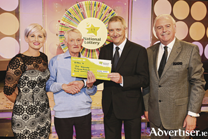 Pictured at the presentation of the winning cheques were from left to right: Sinead Kennedy (Winning Streak game show co-host) Joe Brennan,  Declan Murray (head of security at the National Lottery) and Marty Whelan (Winning Streak game show co-host). The winning ticket was bought from The Gem News, Bridge Street, Ballyhaunis, Photo: MacInnes Photography.