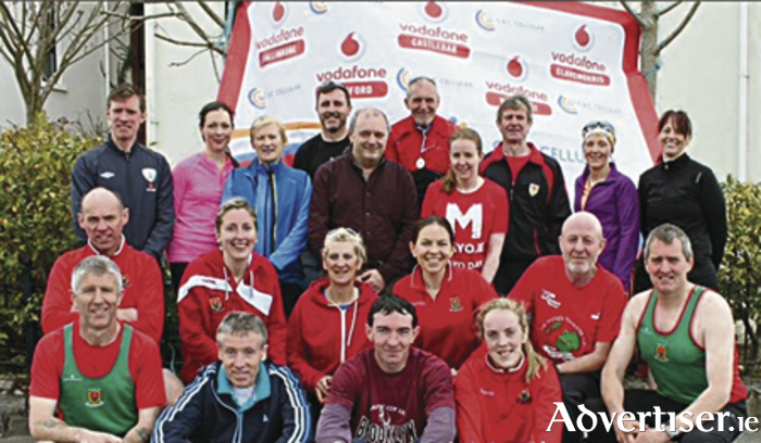 Mayo AC group with sponsor Brendan Chambers Vodafone C&CCellular (standing centre) at the recent  launch of 7th Annual Vodafone Mayo AC 5k Series
