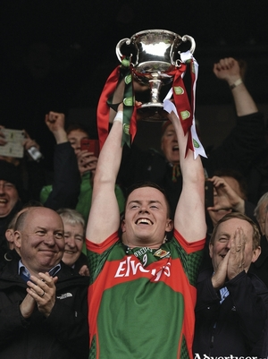 Captain Coen: Stephen Coen lifts the trophy in Ennis. Photo: Sportsfile