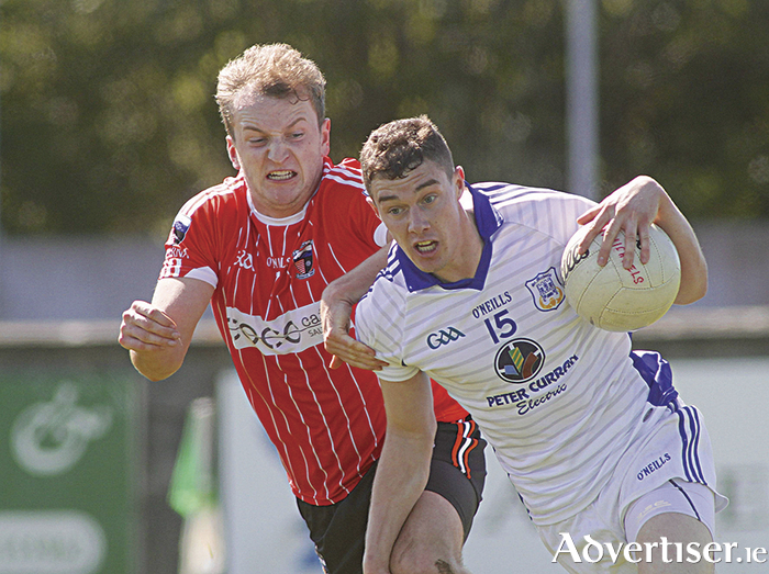 Séarlas ÓTiomáin of Bearna and Eamonn Brannigan St Michael's in action from the opening round of the Galway County Senion Football championship game at Moycullen on saturday. Photo:-Mike Shaughnessy