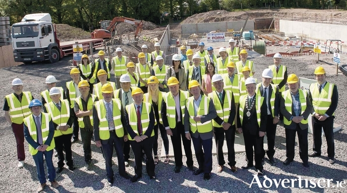 An Taoiseach Enda Kenny laid the foundation stone for the new swimming pool and outdoor pursuits academy in Castlebar at Lough Lannagh this week. Also in the photo are contractors, officials, and elected representatives. Photo: Tom Campbell.