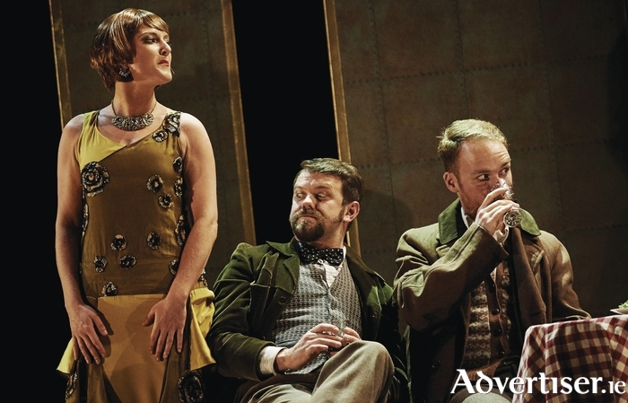 Sinead Campbell-Wallace (Musetta), Rory Musgrave (Schaunard), and Padraic Rowan (Colline) in Opera Theatre Company's La Boheme.
