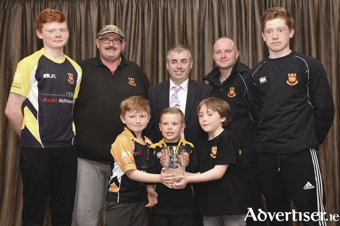 Buccs Minis were presented with an award by Deputy Kevin 'Boxer' Moran for the best overall entry in this year's St Patricks Day Parade. Pictured at the presentation were (back l-r) Sam Fogarty, Diarmuid Sloane, Deputy Moran, Paul Fogarty, and Jack Norton; (front l-r) members of Buccs Minis