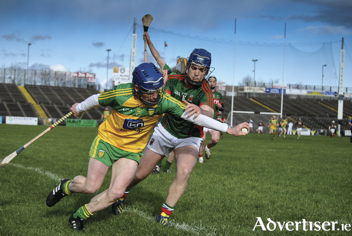 Man and ball: Kenny Feeney battles for possession against Donegal. Photo: Ciara Buckley