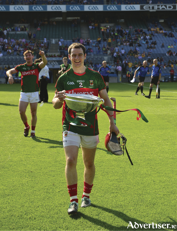 Done and dusted: Mayo captain Brian Hunt heads from Corke Park with the Nicky Rackard Cup in hand. Photo: Sportsfile
