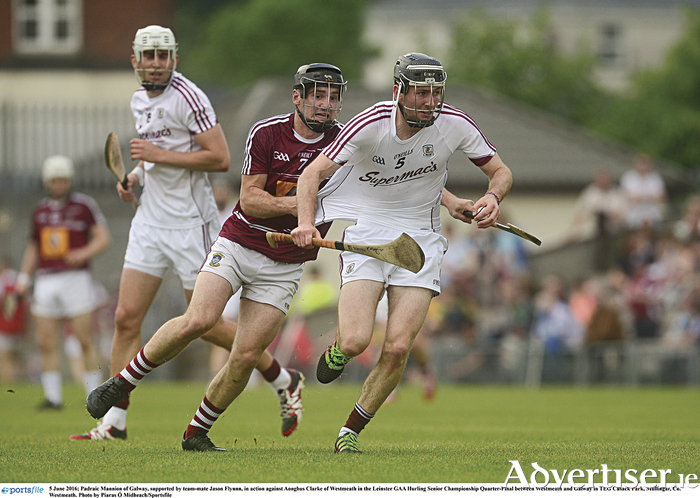 Padraic Mannion of Galway, supported by teammate Jason Flynnn, shrugs off Aonghus Clarke of Westmeath in the Leinster GAA Hurling Senior Championship quarter-final in TEG Cusack Park, Mullingar.