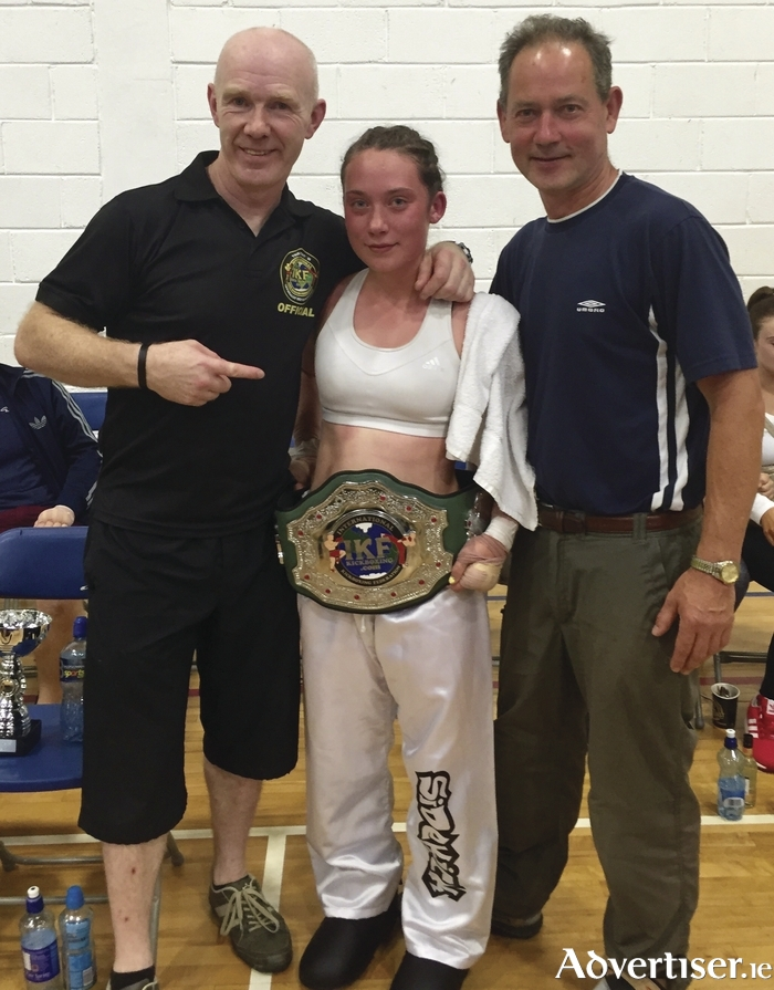 Coach Pete Foley, new All Ireland champion Catherine Jennings and her proud dad Mike.