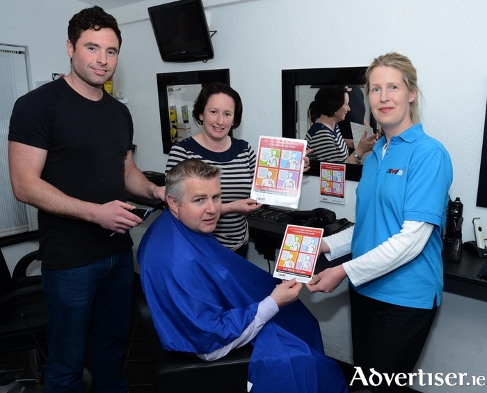 Mayo Senior Football Manager Stephen Rochford is pictured receiving information on heart attack from Ailish Houlihan, Croí Nurse and Ann Marie Brown, Co-ordinator of Cardiac Rehab, Mayo University Hospital, while getting his hair done in David Simon's Barbers in Ballinrobe. Photo: Frank Dolan