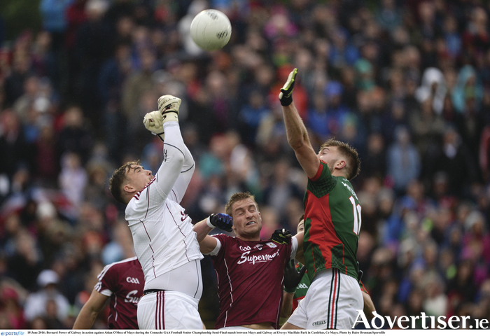 Eyes on the ball: Aidan O'Shea challenges Bernard Power for the ball. Photo: Sportsfile.