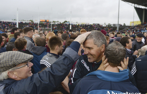 The pat of approval: Kevin Walsh takes the congratulations from a Galway supporter after the full time whistle in Castlebar. Photo: Sportsfile