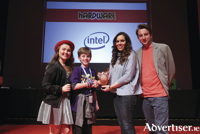 10-year-old Shane Fahy from Athenry pictured with Orla Morris Toolen; Phil Smyth from Swipe TV, and Sarah Sexton from Intel at the CoderDojo Coolest Projects Awards and Launch'd Summit, which were held at the RDS, Dublin. Picture: Conor McCabe.