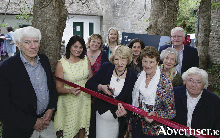 Sabina Higgins cuts the ribbon at the reopening of Yeats Castle, Thoor Ballylee on Saturday with Joe Hassett, Fidelma Healy Eames, Rena McAllen, Sr DeLourdes Fahy. Back row. Helen Monaghan, Deirdre Holmes, Angela Guillemet, Lelia Doolan, Joe Byrne. Photo:-Mike Shaughnessy