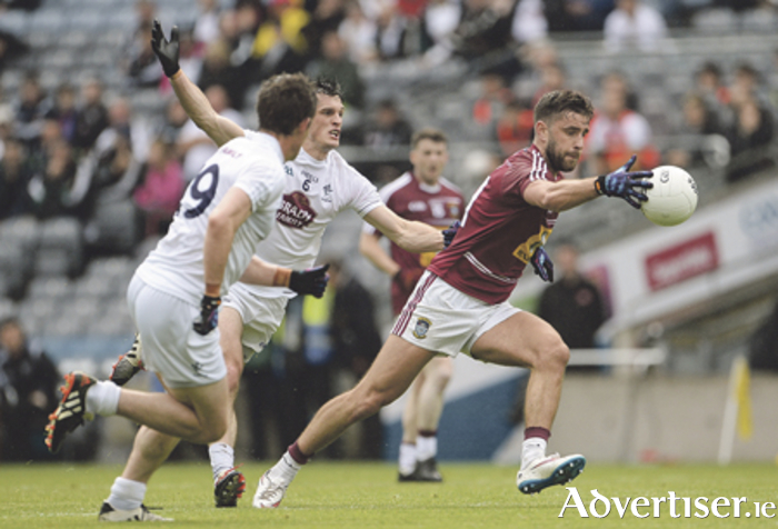 Paul Sharry of Westmeath leaves Eoin Doyle of Kildare in his slipstream during the Leinster GAA Football Senior Championship semi-final at Croke Park last weekend. Photo: Oliver McVeigh/Sportsfile