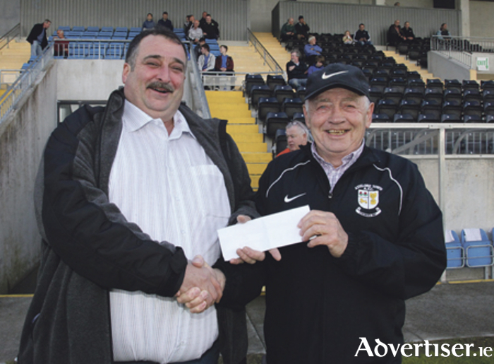 Brendan Conroy of Nuts Corner was the match sponsor for the Athlone Town v Cobh Ramblers game last weekend. He is pictured presenting the cheque to Liam Gaffey.