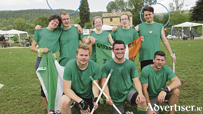 Aine Kilbane and Rebecca O'Connor (back row) hold the Irish flag high ahead of Quidditch World Cup tournament in Frankfurt, Germany.