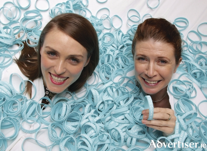 Aoife Kearney of The Front Door Bar with Patrica Philbin project manager Galway 2020 swimming in a sea of Galway 2020 wristbands. Galway 2020 are asking the public to show their support for the European Capital of Culture bid by wearing a wristband.Photo:-Mike Shaughnessy