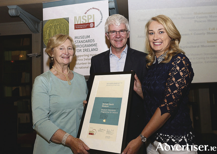 Pictured with Conor Newman, Chair, Heritage Council (middle) were Nancy Smyth and Yvonne Corcoran Loftus of the Michael Davitt Museum, who were awarded interim accreditation from the Heritage Council. Photography Gary O'Neill.