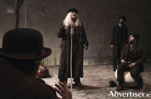 Rory Nolan as Pozzo, Garrett Lombard as Lucky, Mary Rea as Vladimir, and Aaron Monaghan as Estragon in Druid's production of Samuel Beckett's Waiting for Godot. Photo:- Matthew Thompson