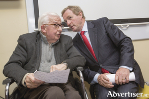 An Taoiseach Enda Kenny speaking with outpatient Leo Shaughnessy after turning the sod on the new extension of the Sacred Heart Hospital in Castlebar on Monday. Photo: Keith Heneghan/Phocus.