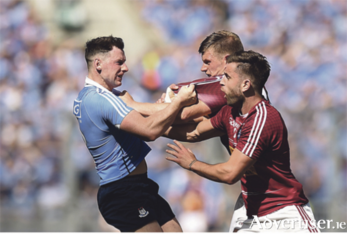 Philly McMahon of Dublin tussles with John Heslin and Paul Sharry of Westmeath during the Leinster final. Photo: David Maher/Sportsfile