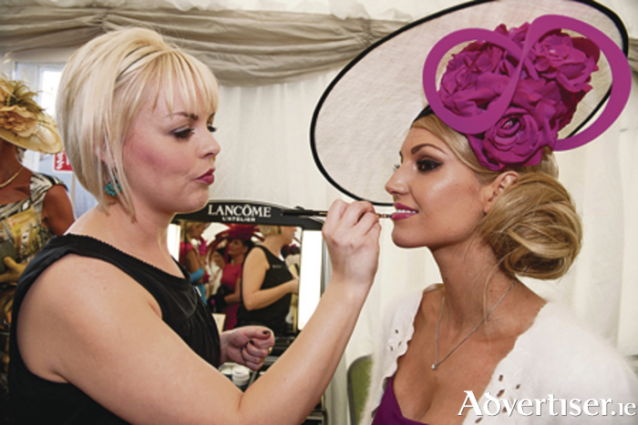 Lancome make-up artist Eileen Hegarty from University Pharmacy applies the finishing touches to former Miss World Rosanna Davison's make-up.
