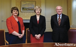 NI First Minister Arlene Foster, British PM Theresa May, and NI Deputy First Minister Martin McGuinness at Stormont on Monday.